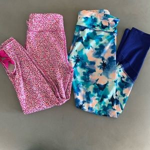 Two pairs of Old Navy's girls Go-dry leggings.